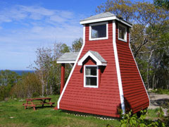 Stay in the lighthouse replica camping cabin with  magnificent Atlantic ocean view.