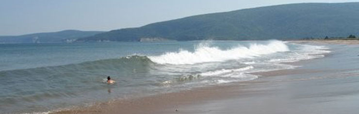 Fun in the surf at South Harbour Beach, walking  distance from Hideaway Campground, Cape Breton, Nova Scotia